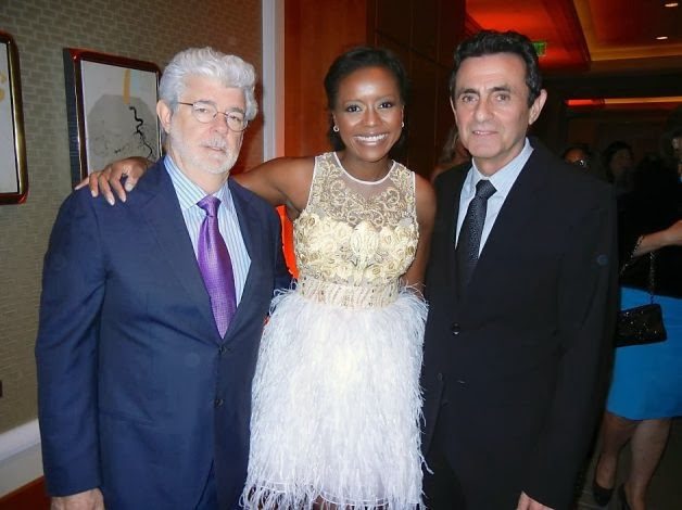 George Lucas (left) with his wife, Mellody Hobson, and SFMOMA Director Neal Benezra